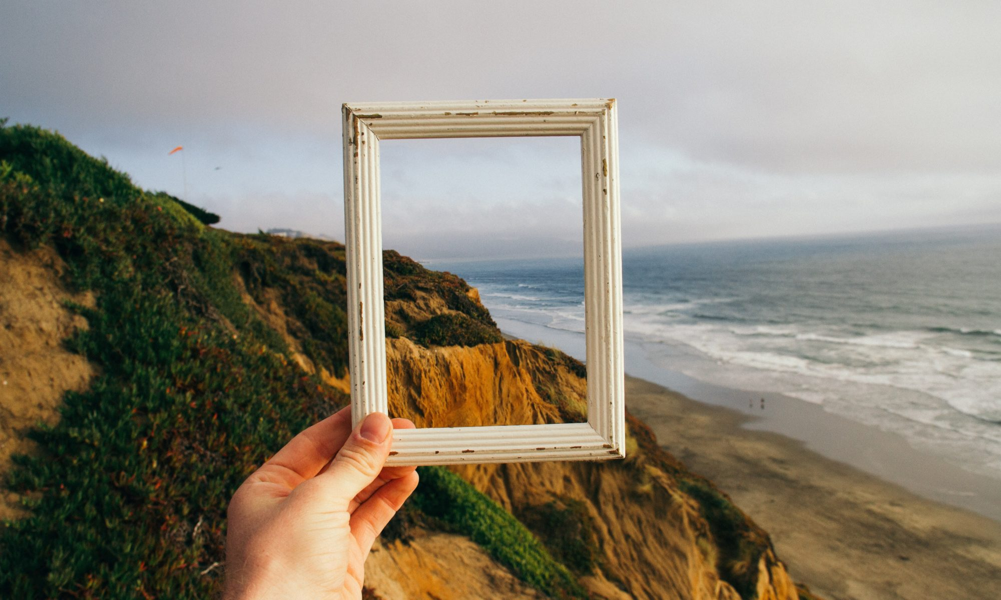 Picture of a empty frame. Sea shore landscape in the background